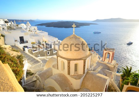 St. John The Baptist's church and the view above volcanic caldera in Fira, Santorini - Thira, Cyclades islands, Greece
