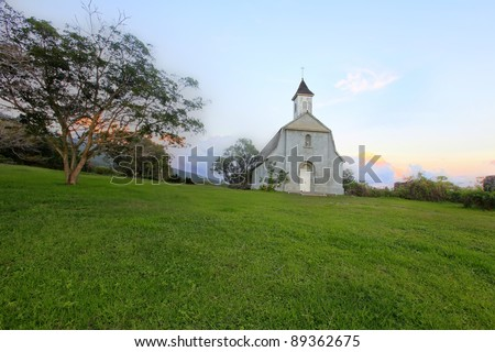 St. Joseph's Church. Maui.  Built in 1862 used to serve a large Hawaiian population. The walls of the old church stand near the new building.