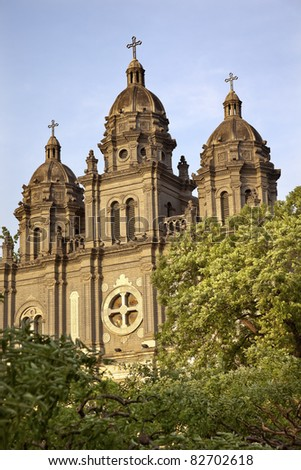 St. Joseph Wangfujing Cathedral, Basilica, Facade Green Trees Church Beijing China.  Very famous Catholic Church built in 1655 and in Boxer Rebellion - stock photo