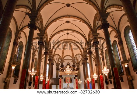 St. Joseph Wangfujing Cathedral, Basilica, Interior Church Beijing China.  Very famous Catholic Church built in 1655 and in Boxer Rebellion  Chinese Character signs are Christian sayings in Chinese - stock photo