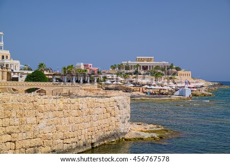 ST JULIAN'S, MALTA - SEPTEMBER 5, 2015: Dragonara Casino and beach on Maltese seacoast, in the city of St Julian's, Malta.