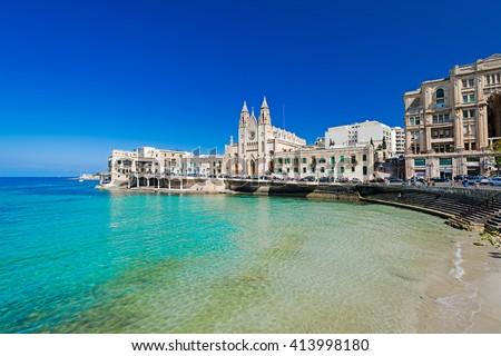 ST JULIANS, MALTA - APRIL 13, 2014: Our Lady of Mount Carmel Church on Balluta Bay in St. Julian's, Malta on April 13, 2014. - stock photo