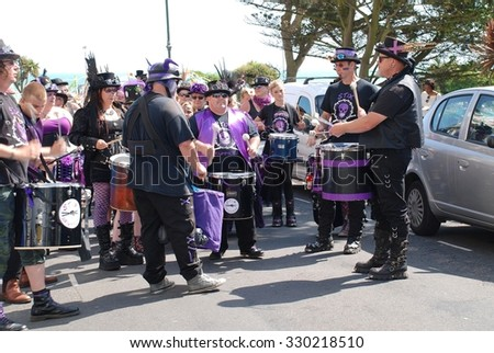 ST.LEONARDS-ON-SEA, ENGLAND - JULY 11, 2015: The Stix Drummers perform during the parade at the annual St.Leonards Festival in Warrior Square. The free entertainment event was first held in 2006. - stock photo