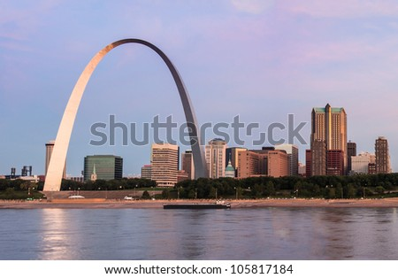 St Louis and The Arch from across the Mississippi river at sunrise - stock photo