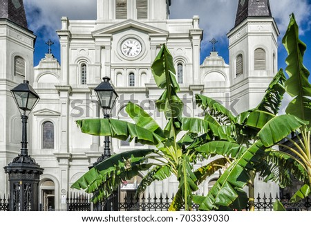 St Louis Cathedral With Banana Trees And Lampposts. New Orleans, LA, USA