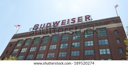 ST. LOUIS - JULY 8, 2012: The Budweiser brewery at the Anheuser-Busch headquarters hosts 300.000 visitors annually on July 8, 2012 in St. Louis. The complimentary tour is offered throughout the year. - stock photo
