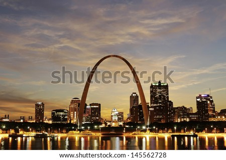 ST. LOUIS - MAY 9: City of St. Louis Skyline at twilight on May 9, 2012 in St. Louis, Missouri. The Gateway Arch is a 630 feet (190 m) high. City of St. Louis is the 19th largest population in the US.