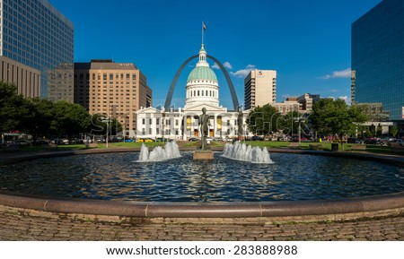 ST. LOUIS, MISSOURI - MAY 27: The Running Man statue in front of the Old Courthouse and Gateway Arch on May 27, 2015 in St. Louis, Missouri - stock photo