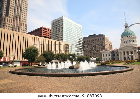 ST. LOUIS, MISSOURI -  SEPTEMBER 18: The Running Man Statue in Kiener Plaza Gateway Mall near the famous Arch, on September 18, 2010. The Old Courthouse was completed in 1864 and is 192 feet high. - stock photo