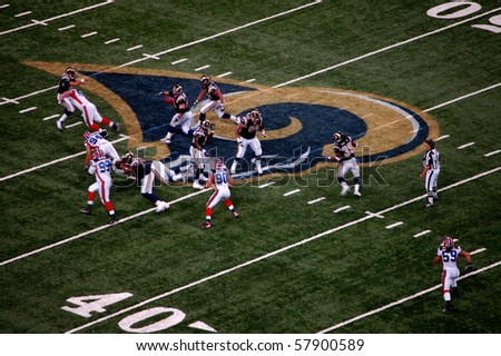 ST. LOUIS - SEPTEMBER 28:  Rams quarterback Trent Green is hit as he throws the ball in a game against the Buffalo Bills at the Edward Jones Dome September 28, 2008 in St. Louis, MO - stock photo