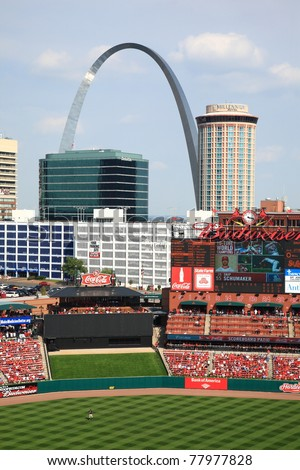 ST. LOUIS - SEPTEMBER 18: The Cardinals scoreboard and the Gateway Arch are seen from Busch Stadium before a game between the Cardinals and Padres, on September 18, 2010 in St. Louis, MO - stock photo