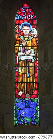 St. Mark and the winged lion.  The winged lion is the evangelical symbol of St. Mark. A stained glass window from the Anglican Bermuda Cathedral built in 1866. Located in Hamilton.