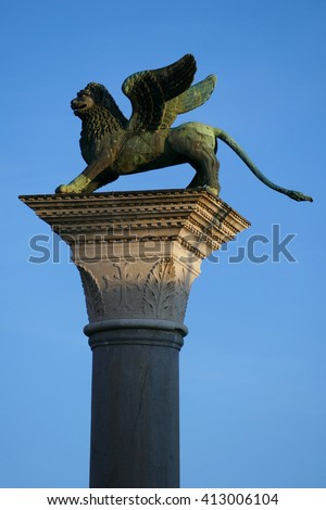 St. Mark's Lion atop its column in Piazzetta (little piazza) San Marco. Venetians will avoid walking between this column and St. Teodoro of Amasea as this was the place where criminals were executed.  - stock photo