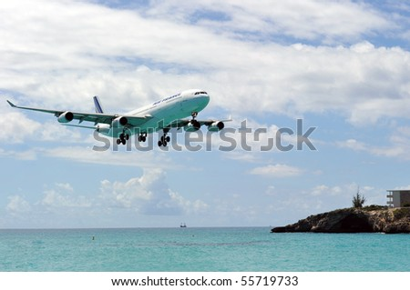 ST MARTIN, ANTILLES - APRIL 13: the tourist office and Air France signs an agreement to strengthen their partnership (joint communication plan). Daily A340 about to touch down in Apr. 2010 at SXM.