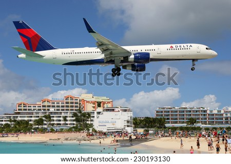 ST. MARTIN - FEBRUARY 8: A Delta Airlines Boeing 757 approaching on February 8, 2014 in St. Martin. St. Martin is rated one of the most dangerous airports in the world. - stock photo