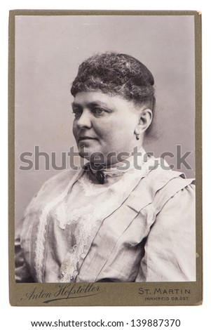 ST. MARTIN, GERMANY - CIRCA 1900: antique portrait of woman wearing vintage clothing, circa 1900 in St. Martin, Germany