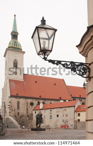 St. Martin's Cathedral (slovak: Katedrala svateho Martina) in Old Town of Bratislava, Slovakia. ancient street lantern in front. - stock photo