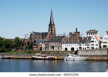 St. Martinuskerk & River Maas Scene, Maastricht, Netherlands - stock photo