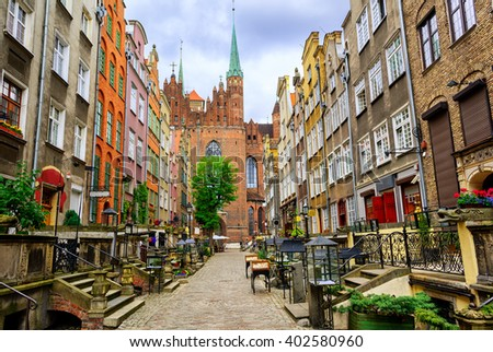 St. Mary's church and Mariacka street in the old town center of Gdansk, Poland - stock photo