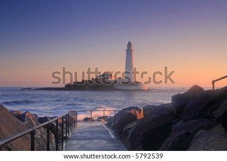St Mary's Lighthouse at sunrise with the high tide cutting it off from the mainland