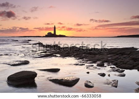 St Mary's Lighthouse near Whitley Bay in Northumberland at sunrise - stock photo
