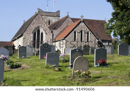 St Marys Church in Selborne, Hampshire, England.  An English church and grave yard taken during summer. - stock photo
