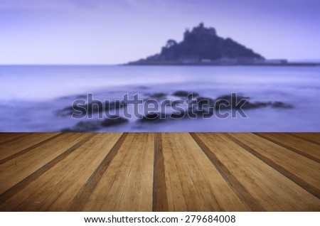 St Michael's Mount Bay Marazion landscape pre-dawn long exposure Cornwall England with wooden planks floor - stock photo
