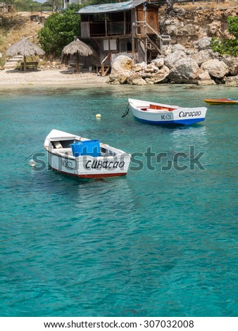 St Michel views - beach, fort and boats - Views around Curacao a small Caribbean Island in the ABC islands - stock photo