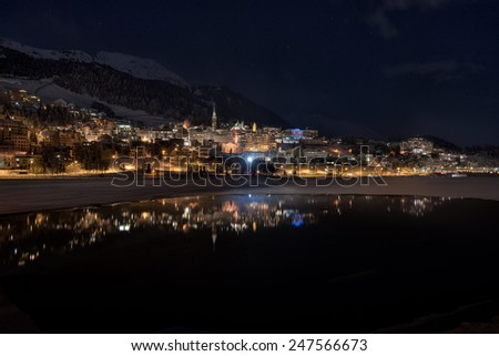 St.moritz mirrored in the lake