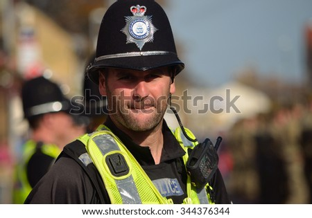 ST NEOTS, CAMBRIDGESHIRE, ENGLAND - OCTOBER 20, 2015: British Police on duty in numbers - stock photo