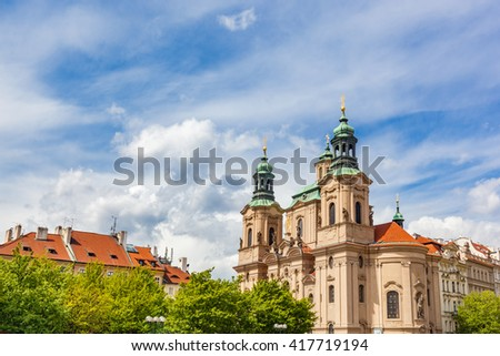 St. Nicholas Church in the Old Town of Prague, Czech Republic. Sunny day, blue sky - stock photo