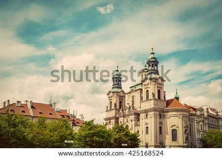 St. Nicholas Church in the Old Town of Prague, Czech Republic. Vintage, sunny blue sky - stock photo