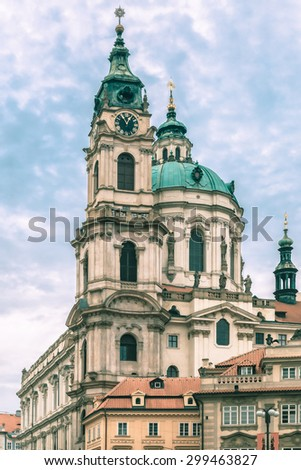 St. Nicholas Church, the baroque church on Lesser Town Square in Prague, Czech Republic. Toning in cool tones