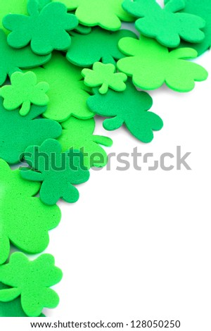 St Patrick's Day border of clover leaf shapes over white - stock photo