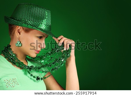 St Patrick's day Girl. Young woman wearing green hat  - stock photo