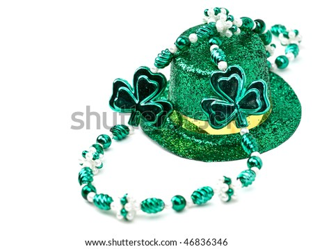 St. Patrick's Day inspired still-life of a glittering top hat and beads on white - stock photo