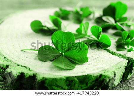 St. Patricks day,  clover leaves on green wooden background - stock photo