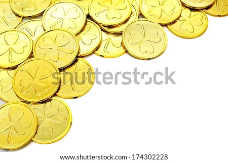 St Patricks Day gold coin corner border over a white background - stock photo