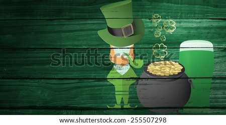 St patricks day graphics against overhead of wooden planks - stock photo