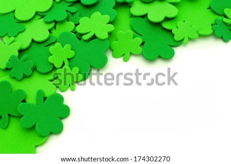 St Patricks Day shamrock corner border over a white background - stock photo