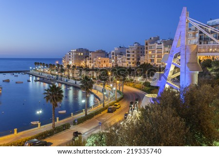 St Paul Bay and the Harbor in Bugibba on the Island of Malta at night - stock photo