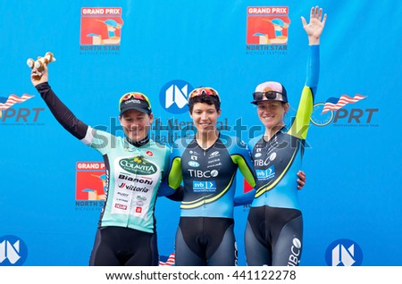 ST. PAUL, MINNESOTA - JUNE 15, 2016: Winners podium at North Star Grand Prix pro cycling event time trial in St. Paul on June 15 from left are Lauretta Hanson, Brianna Walle and Lauren Stephens.  - stock photo