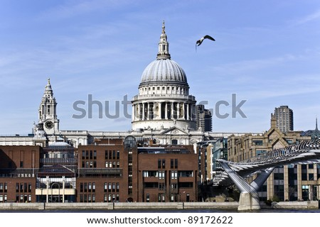 St Paul`s Cathedral and Millennium Bridge - stock photo