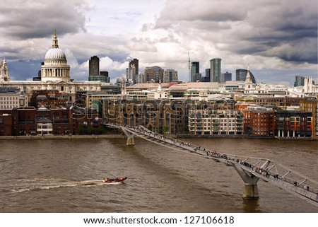 St Paul's Cathedral and Millennium bridge seen from Tate Modern - stock photo