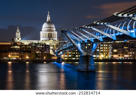 St Paul's Cathedral and Millennium Footbridge over the Thames  - stock photo