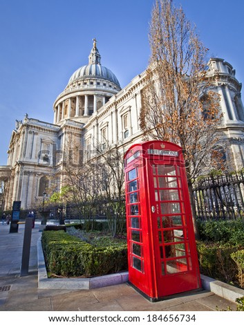 St. Paul's Cathedral and Red Telephone Box in London.  - stock photo