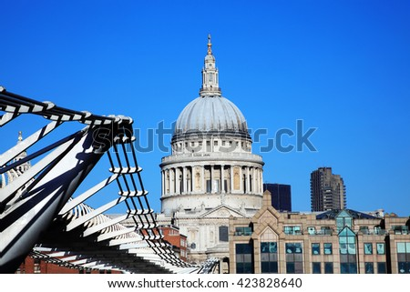 St Paul's Cathedral and the Millennium Bridge in London, England,UK, linking Bankside with The City across the River Thames