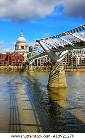 St Paul's Cathedral and the Millennium Bridge over the Thames, London. - stock photo