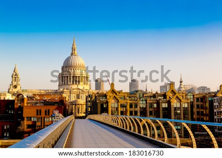 St Paul's Cathedral from the Millennium Bridge at Dawn, London, England, UK - stock photo