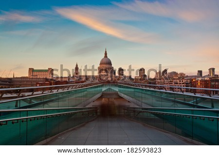 St Paul's Cathedral overlooks the River Thames and the Millennium Bridge. London, UK.